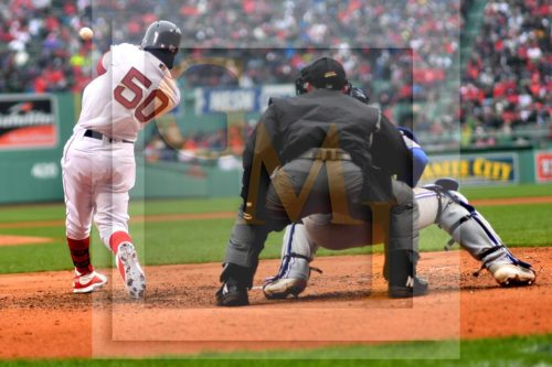 Boston Red Sox right fielder Mookie Betts hits a home run