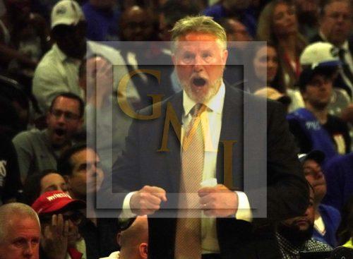 Philadelphia 76ers head coach Brett Brown cheers his team on