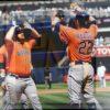 Astros first baseman Tyler White celebrates hitting his first grand slam