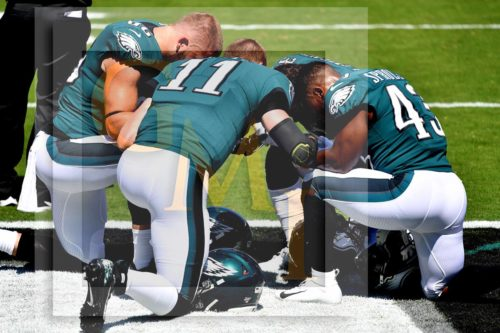 Prior to the Eagles first home game Carson Wentz leads a prayer with Zach Ertz, Darren Sproles, and Corey Clement
