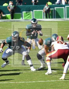 Philadelphia Eagles quarterback, Carson Wentz, takes the snap from center Jason Kelce