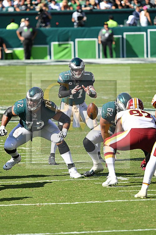 Philadelphia Eagles quarterback, Carson Wentz, takes the snap from center Jason Kelce