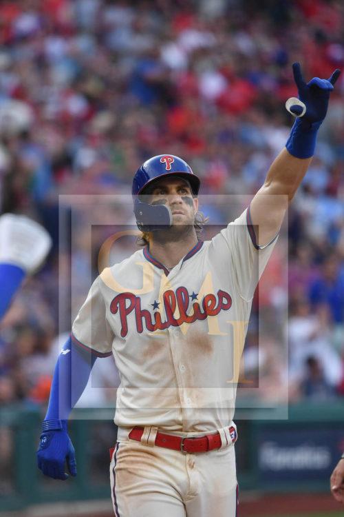Philadelphia Phillies right fielder, Bryce Harper, celebrates hitting his 29th home run