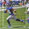 New York Giants running back Saquon Barkley out runs Buffalo Bills free safety Micah Hyde