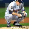 Houston Astros starting pitcher Zack Greinke takes a kneeling break