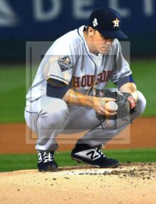 Houston Astros starting pitcher Zack Greinke takes a kneeling break