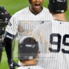Yankees Aaron Hicks celebrates hitting a three-run home run