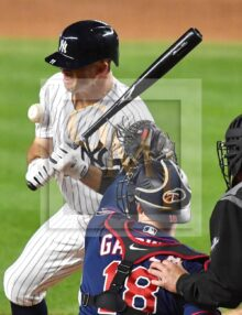New York Yankees outfielder Brett Gardner is hit by a pitch