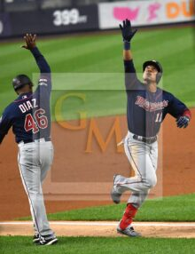 Minnesota Twins infielder Jorge Polanco celebrates home run