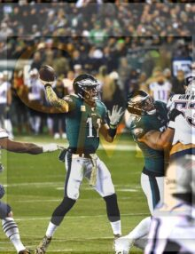 Eagles quarterback Carson Wentz throws a touchdown
