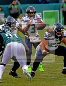 Seahawks quarterback RUSSELL WILSON takes the snap