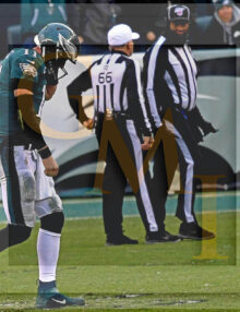 Eagles Carson Wentz walks off the field dejected