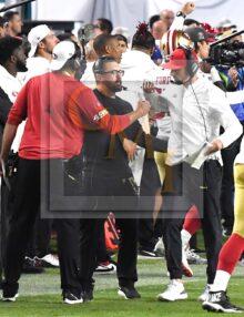 San Francisco 49ers head coach Kyle Shanahan fist pumps his coaches