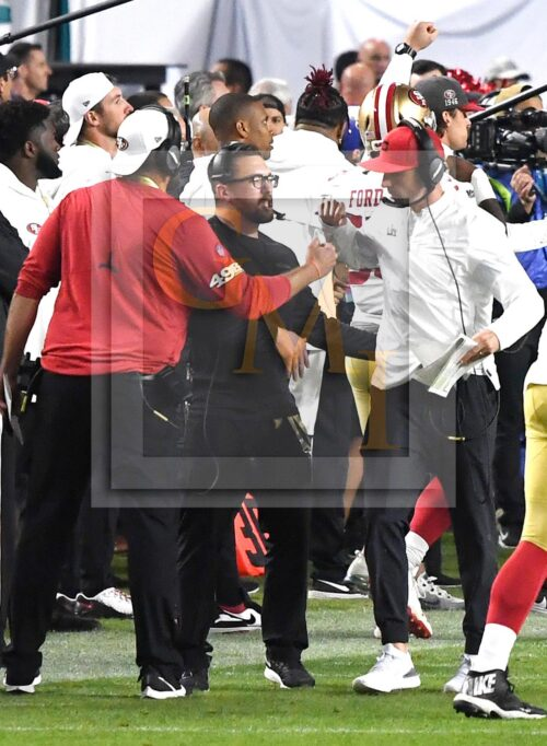 San Francisco 49ers head coach Kyle Shanahan fist pumps his coaches