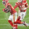 Chiefs quarterback Patrick Mahomes hands off to running back Damien Williams